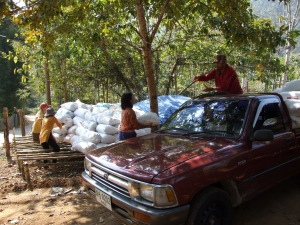 Unloading and stacking bags of rice husks