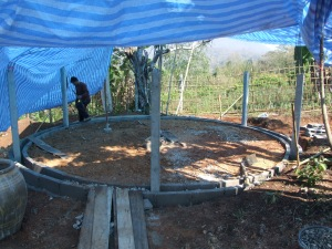 The base of the Jungle Dome gets a concrete surround for termite and rain water protection.