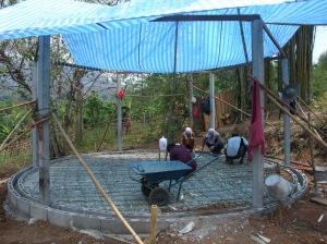 Fixing the bamboo trellis to strengthen the concrete foundation.