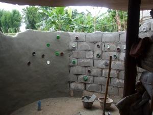 Half the bathroom wall has been plastered.