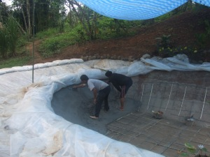 Polishing the cement to give it a smooth waterproof finish.