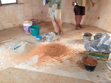 Sand and earth sifted through wire mosquito net ready to mix into a wall plaster.