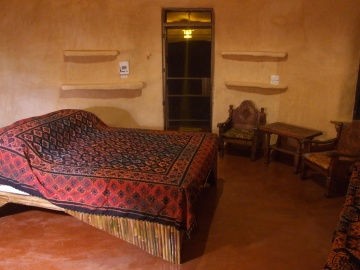 Note the bamboo bed, old teakwood furniture and lovely warm plastered walls.