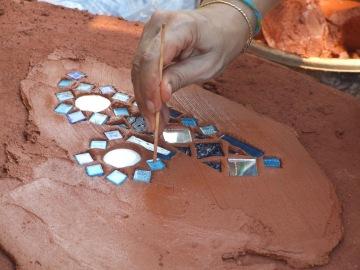 Su Lupasco Washington working on a mosaic decoration on a roundhouse step. www.sulupascowashington.com