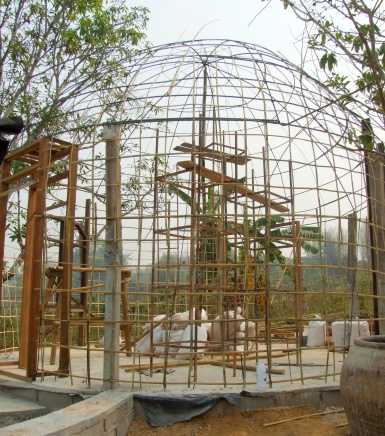 This is the framework of bamboo and steel that I call a 'birdcage'.