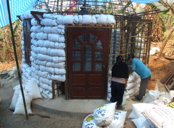 The bags of rice husks go up forming the walls of the dome.