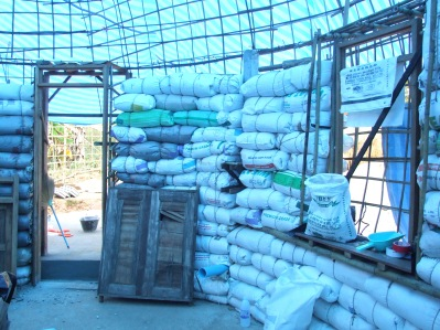 Bags of rice husks form the walls – the amazing colour comes from the blue tarpaulin protecting us from the heat of the sun.